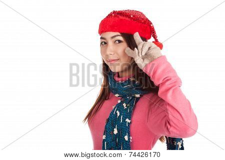 Asian Girl With Red Christmas Hat Show Two Fingers