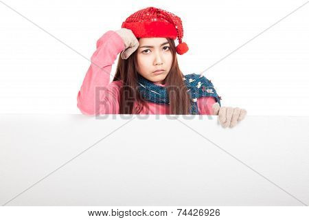 Asian Girl With Red Christmas Hat In Bad Mood With Blank Sign
