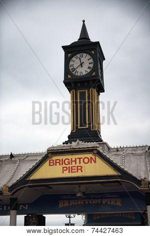 Brighton Pier Clock Tower Under Cloudy Skies in Brighton, England