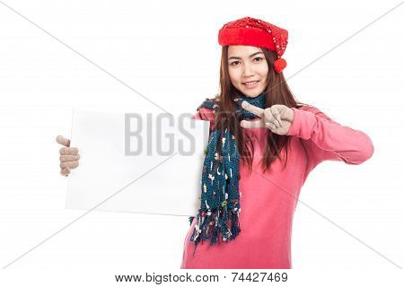 Asian Girl With Red Christmas Hat Show Two Fingers And  Blank Sign