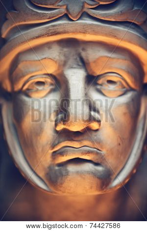 Close up Roman Human Face Sculpture Art Reflected by Light.