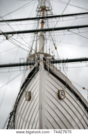 Low Angle Detail of Tall Ship Bow or Stern with Mast in Background
