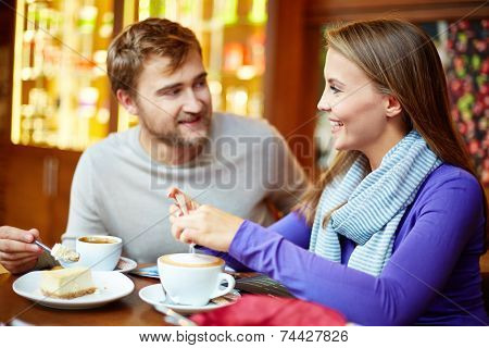 Young affectionate couple spending time in cafe