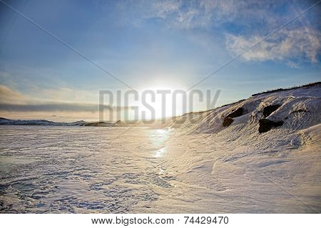 sunset on winter Baikal lake