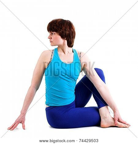 Beautiful woman doing yoga. Isolated on white