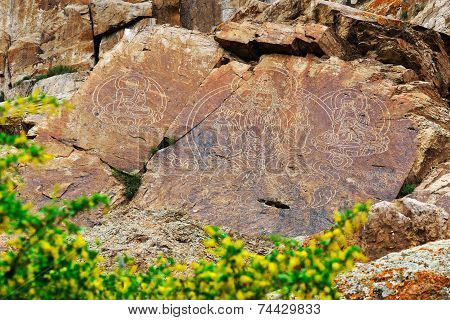 Petroglyphs (rock paintings) of Buddha in Kazakhstan