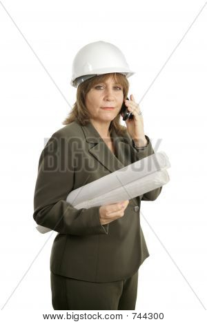 Confident Female Architect on Cellphone
