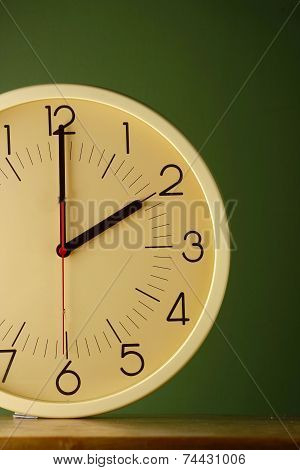 An analog clock at two o'clock position