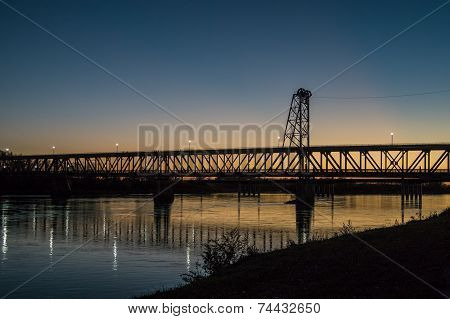 Bridge silhouetted by evening sun