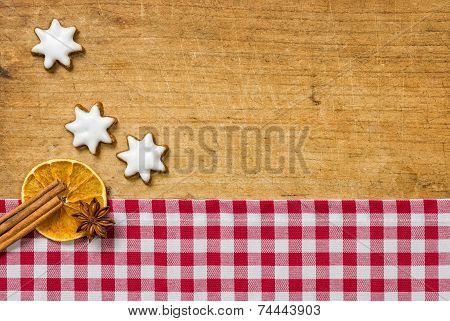 Wooden background with cookies and christmassy spices