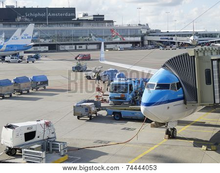 LM plane being loaded at Schiphol Airport