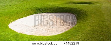 Two Deep Sand Bunkers On A Golf Course