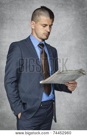Portrait Of A Businessman Who Reads The Newspaper