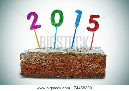 numbers forming the number 2015, as the new year, on a piece of cake