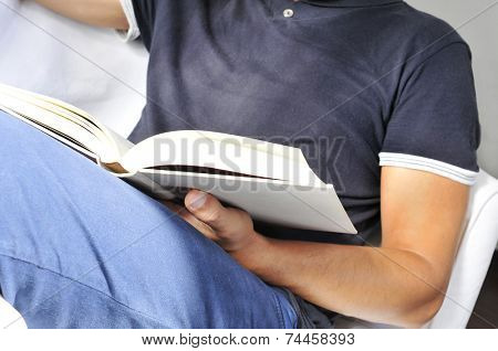 a young man reading a book