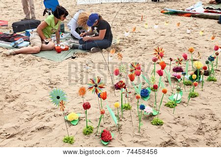 Flowerbed Of Paper Flower On The Beach