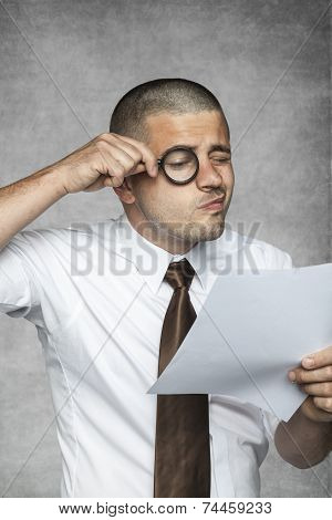Businessman Intently Reads The Contract