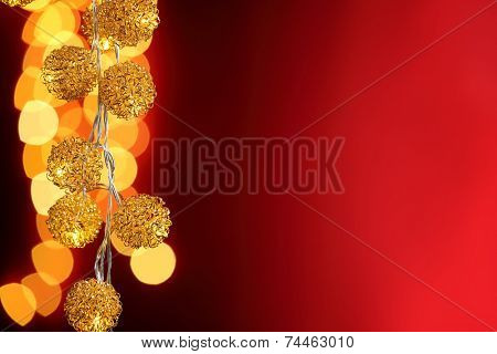 Dark red background with Christmas lights.