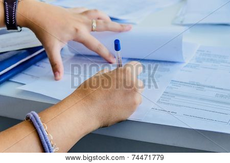 Woman Signs A Document