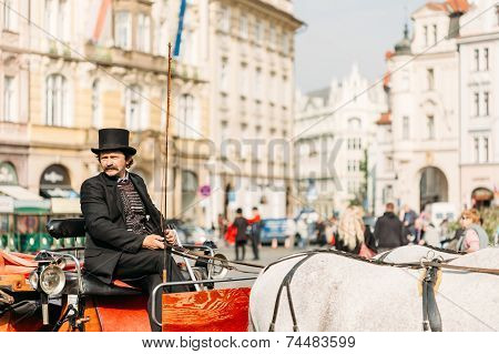 Old-fashioned Coach And Coachman At The Old Town Square In Prague, Czech Republic