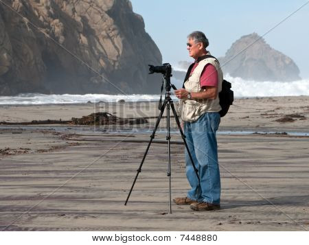 Photographer Shooting On Beach