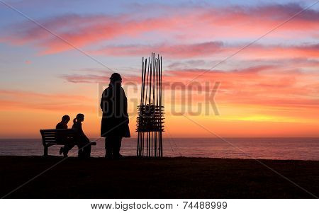 Two Sculptures Two Spectators, Sunrise Sculpture By The Sea