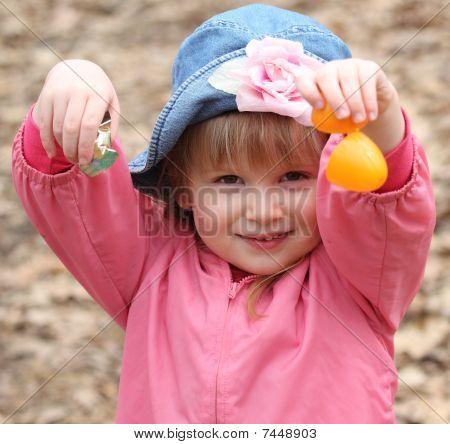 Little Girl Opens Easter Egg For Candy