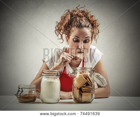 Young woman eating biscuits