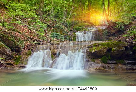 Nice waterfall in deep green forest