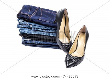 Stack of Jeans and a Pair of High Heel Shoes