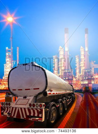 Beautiful Lighting Of Oil Refinery Plant In Heavy Petrochemical Industry And Container Truck Transpo