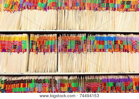 Medical files on a shelf