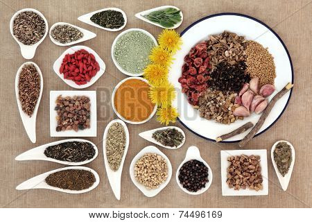 Liver detox food selection in white dishes over brown paper background..