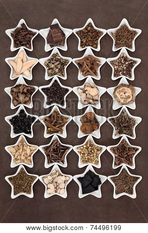 Large chinese herbal medicine selection in star shaped porcelain bowls.