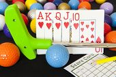 pic of flush  - Royal flush poker hand with mini golf putter balls and score card - JPG