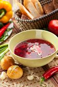 stock photo of pampushka  - Beetroot and Cabbage Soup with Bread - JPG