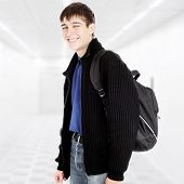 foto of knapsack  - Cheerful Teenager with Knapsack in the White Corridor - JPG