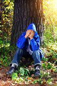 pic of sorrow  - The Sorrowful Teenager sitting in the Forest - JPG