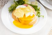stock photo of benediction  - Eggs benedict close up on white plate serving table