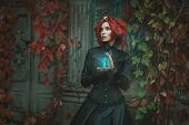 picture of wraith  - Fabulous girl with red hair she is holding an hourglass - JPG
