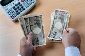stock photo of yen  - japanese yen notes - JPG