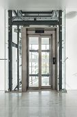 picture of elevators  - View of glass elevator in a building