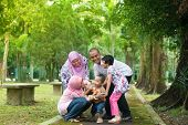foto of southeast asian  - Family playing at outdoor garden park - JPG