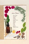 picture of pagan  - Pagan love potion ingredients over natural hemp notebook and mottled cream paper background - JPG
