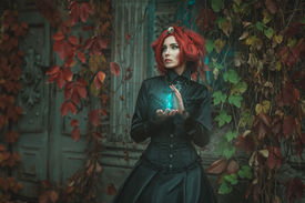 pic of wraith  - Fabulous girl with red hair she is holding an hourglass - JPG