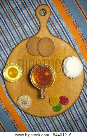 Cup Of Tea With Various Sweets