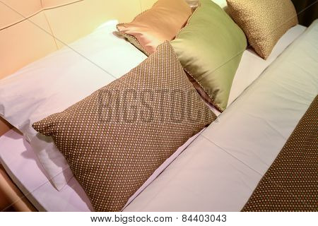 Luxury Hotel Room Setting With Bed And Pillows.