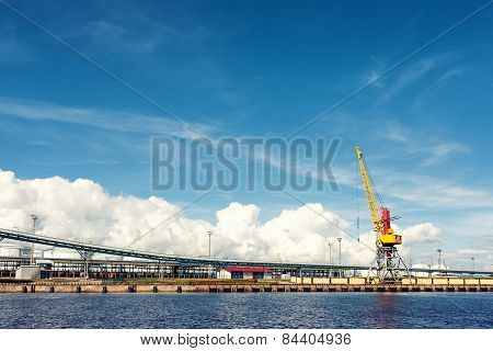 Cargo Crane In The Port Against The Sky In Summer