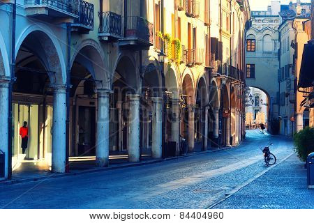 Bike On The Street Arcades In The Early Morning In Mantova