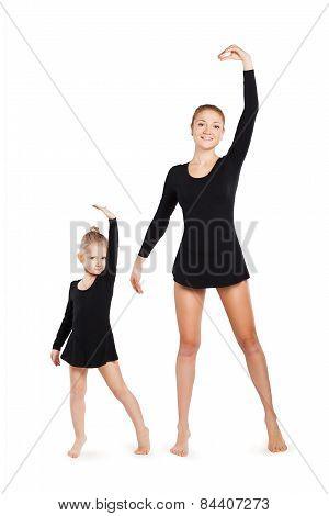 Mom teaching daughter gymnastics.
